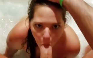 Brunette whore swallowing a huge dick in the bathroom