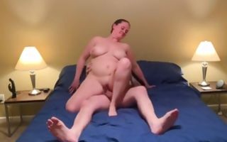 Naked babe on the bed licking cunt and gets poked
