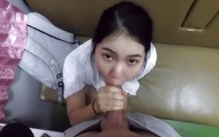 Cute Asian cutie gives him a hand job and blows his donger