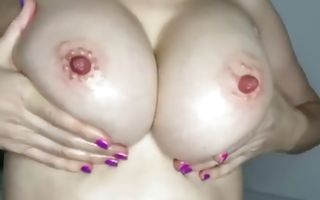 Kinky babe with giant boobs touching herself