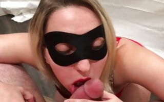 Hot blonde wearing a mask swallowing huge dick