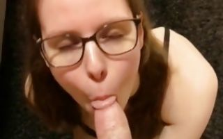 Hot brunette on her knees swallowing a huge cock