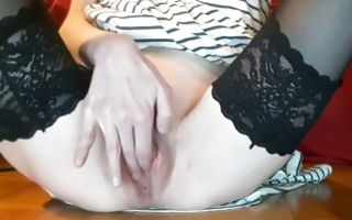 Teen babe in her stockings fingering her shaved cunt