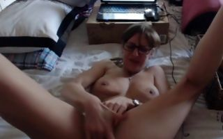 Horny nerdy brunette in glasses fingers her clit in amateur xxx