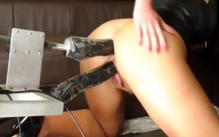 Pretty brunette amateur slut gets fucked by a dildo machine in solo